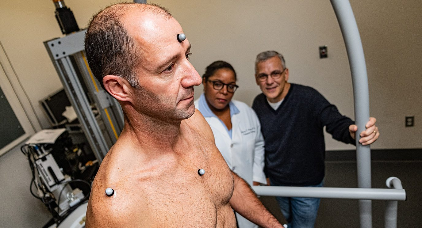 Physical therapist Alexander Penny is wired with motion capture technology.