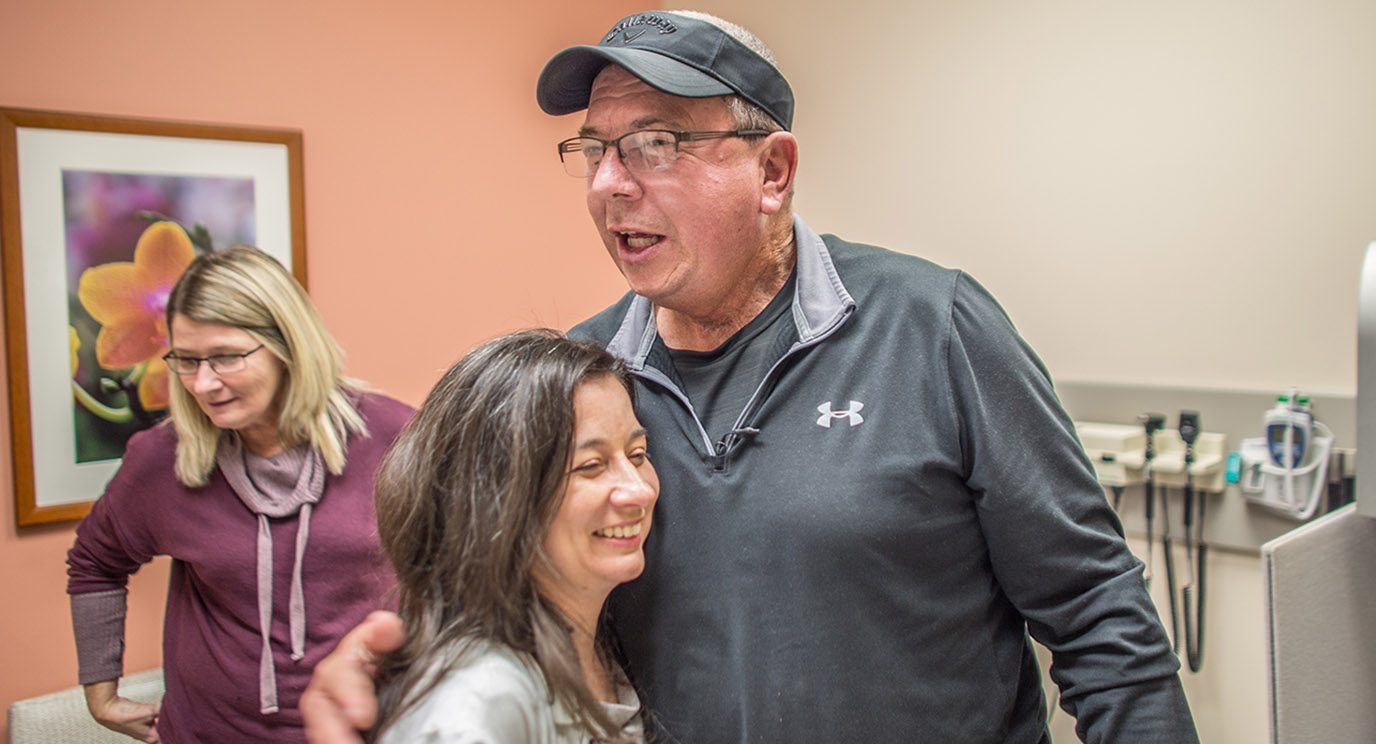 Max Nickless hugs Maria Cabanillas, M.D., after learning his thyroid cancer is shrinking.