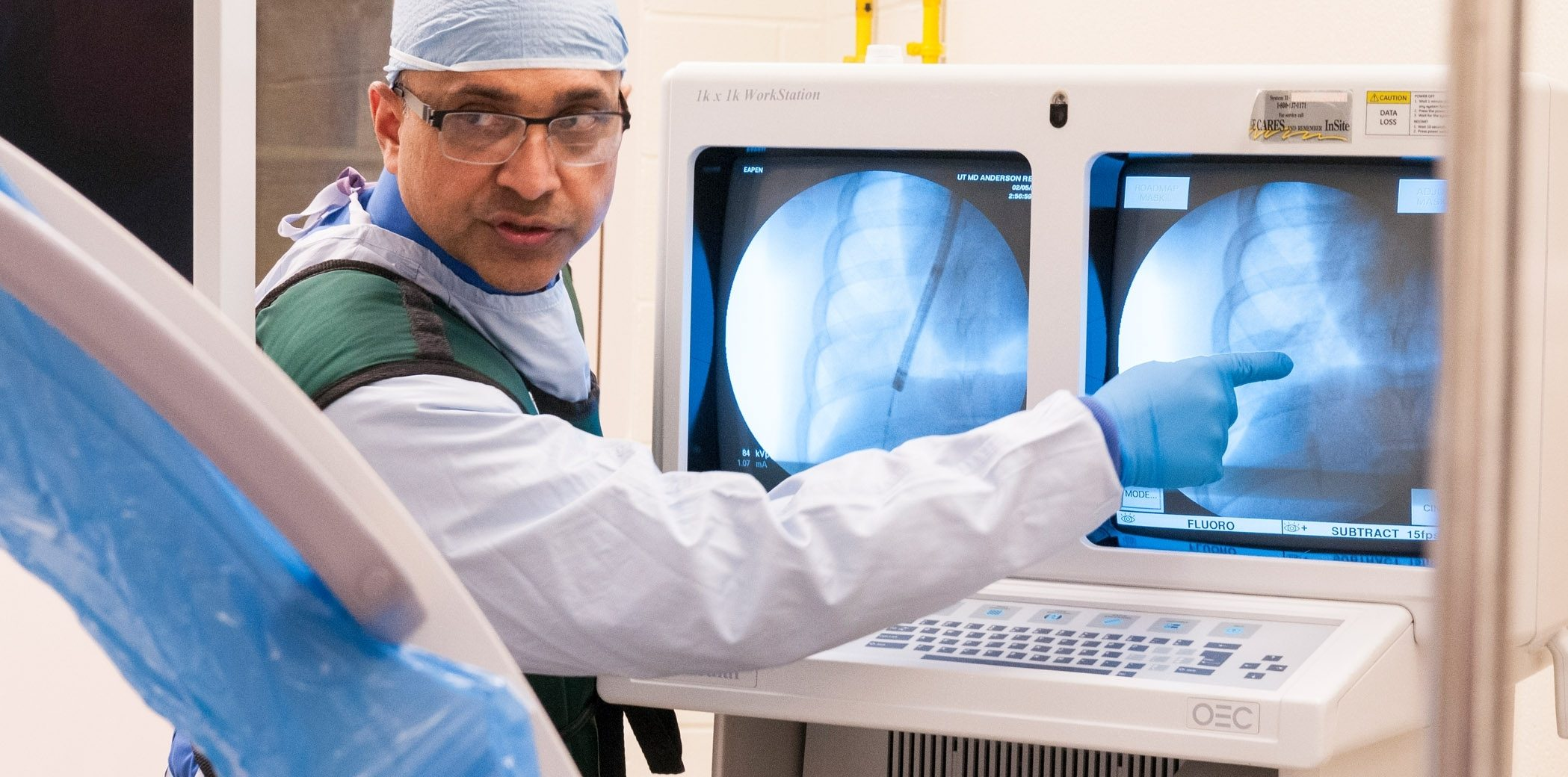 Pulmonologist George Eapen, M.D., examines lungs of patient undergoing cancer treatment