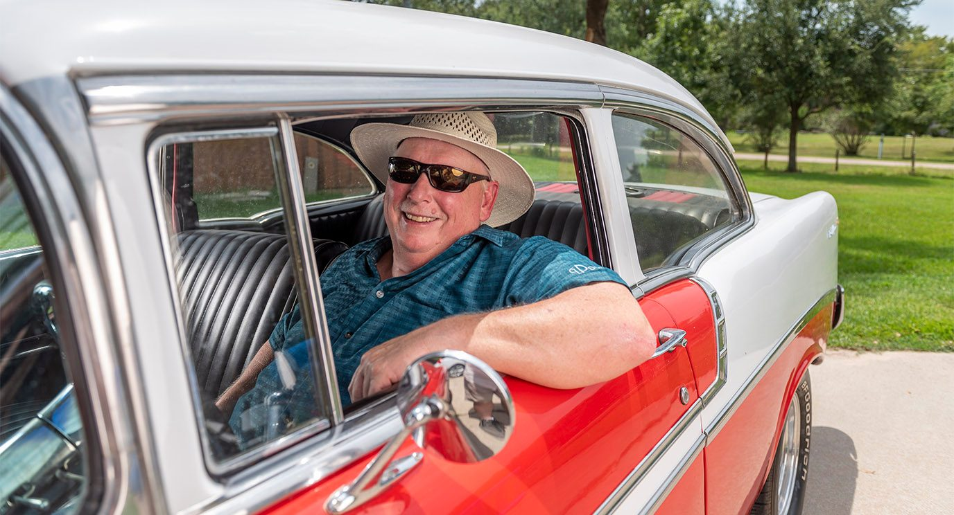 Gary Price in a vintage car
