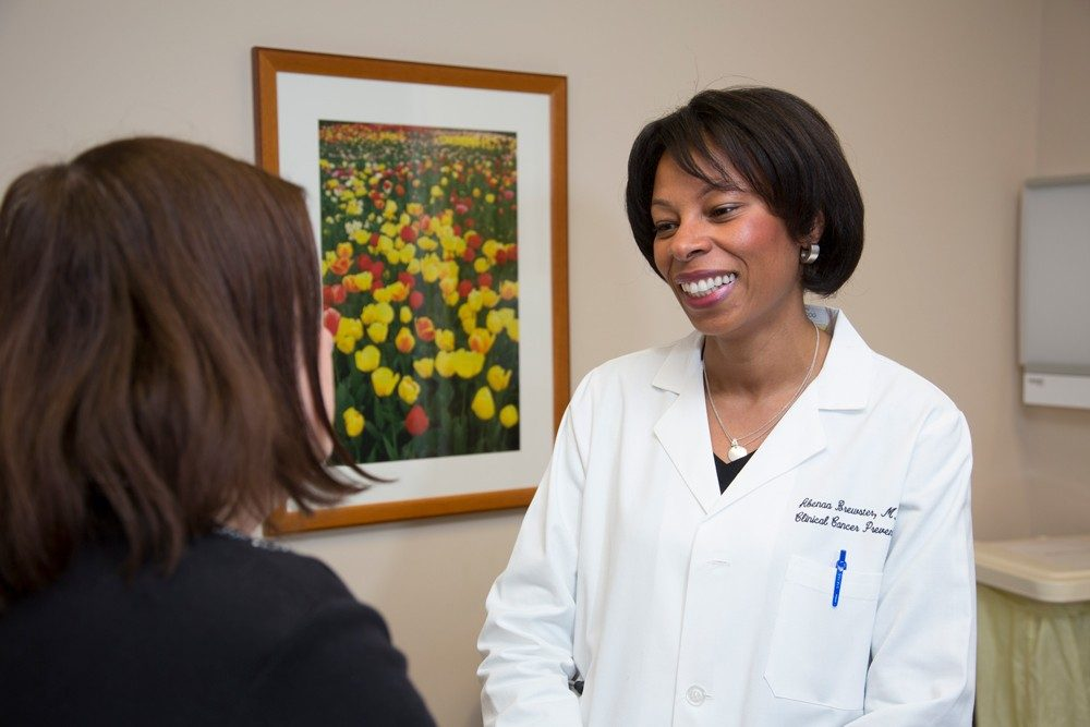 Abenaa Brewster, M.D., with a patient