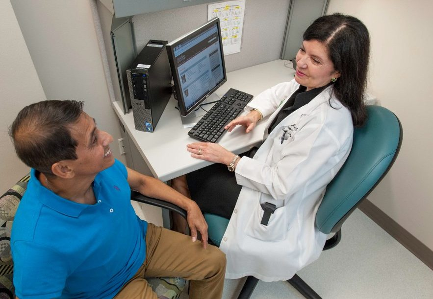 MD Anderson internal medicine physician Carmen Escalante with a patient