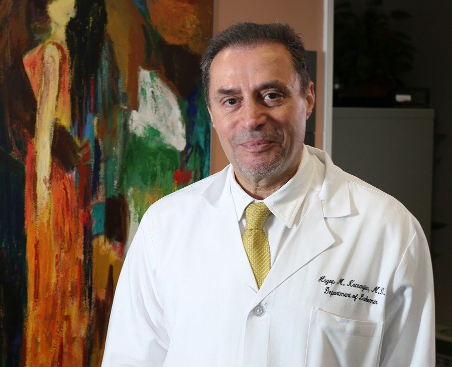 Hagop Kantarjian, M.D., with one of his paintings