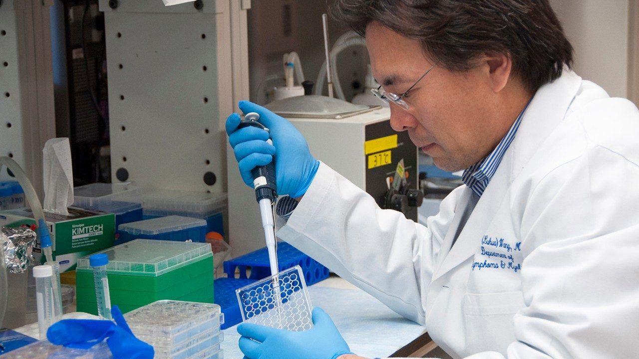 Dr. Michael Wang working in lab